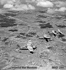 Airplane Picture - December 1942. Four Lysander Mk IIIAs of No. 1433 Flight RAF, based at Ivato, over a typical Madagascar landscape, shortly after the official end of the Madagascar campaign. (Photographer: Sgt J.D. Morris).