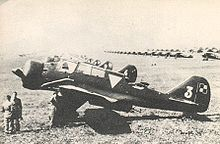 Airplane Picture - PZL.23A Karas on the Warsaw Airport. Note lines of PZL P.11 or PZL P.7 fighters in the background