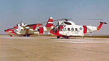 Airplane Picture - U.S. Coast Guard Grumman HU-16E Albatross and a Sikorsky HH-52A Seaguard in March 1964, probably at CGAS Mobile, AL