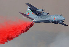 Airplane Picture - A C-130E fitted with a MAFFS dropping fire retardant