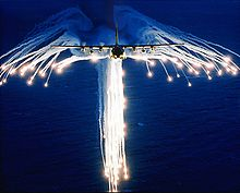 Airplane Picture - A Hercules deploying flares, sometimes referred to as Angel Flares due to the characteristic shape