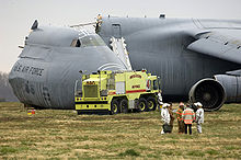 Airplane Picture - Emergency responders at the scene of a C-5B crash at Dover AFB, Del., April 2006