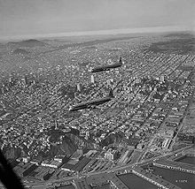 Airplane Picture - The two XR6V Constitutions in flight over San Francisco in 1950