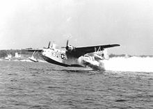 Airplane Picture - A US Coast Guard PBM takes off from the water assisted by RATO.