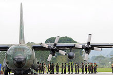 Airplane Picture - Philippine Air Force and Army servicemen unload a C-130 of supplies for transfer to waiting U.S. helicopters for delivery to Panay Island.