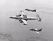 Airplane Picture - VAQ-33 NC-121K in 1973, flanked by an F-4B Phantom II and an EA-4F Skyhawk.