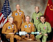 Aircraft Picture - Apollo-Soyuz crews with model of spacecrafts, 1975