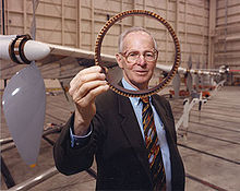 Aircraft Picture - AeroVironment Chairman Paul MacCready shows a cross section of the AeroVironment/NASA Helios Prototype wing spar.