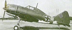 Aircraft Picture - A Reggiane Re 2002 at Taliedo in early 1945, bearing German markings in preparation for delivery to a German Luftwaffe Schlachtgruppe.