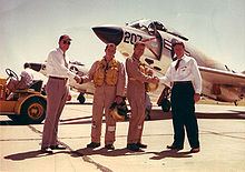 Airplane Picture - F3H Demon delivery. On the right, Wally Schirra shakes hands with Dave Lewis.