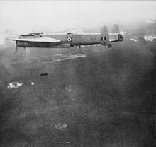 Airplane Picture - RAAF Lincoln bomber dropping 500 lb bombs on Communist targets during the Malayan Emergency, c. 1950