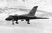 Airplane Picture - Vulcan B.1 XA890 in early silver scheme landing at Farnborough in September 1955 after Roly Falk's