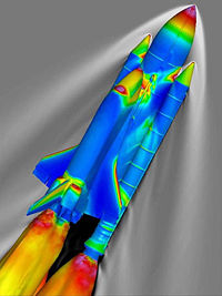 Airplane Picture - SSLV at Mach 2.46 and 66,000 ft (20,000 m). The surface of the vehicle is colored by the pressure coefficient, and the gray contours represent the density of the surrounding air, as calculated using the overflow codes.