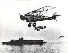 Airplane Picture - Fleet Air Arm Blackburn Shark in company with a Westland Wapiti, seen flying over HMS Courageous.