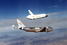 Airplane Picture - OV-101 Enterprise takes flight for the first time over Dryden Flight Research Facility, Edwards, California in 1977 as part of the Shuttle program's Approach and Landing Tests (ALT).
