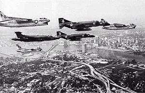 Airplane Picture - A flight of three U.S. Navy Vought A-7E Corsair IIs, two Royal Navy McDonnell Douglas Phantom FG.1 and a Royal Navy Blackburn Buccaneer S.2 over Jacksonville, Florida in 1976. The Phantoms were from No. 892 Naval Air Squadron, and the Buccaneer from No. 809 Naval Air Squadron, of HMS Ark Royal (R09)�s air group.