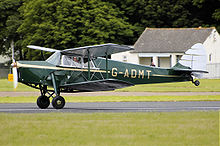 Airplane Picture - 1936 de Havilland DH87B Hornet Moth taking off at Kemble Air Day, Wiltshire, in 2008