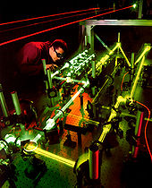Airplane Picture - A technician evaluates the interaction of multiple lasers that will be used aboard the Airborne Laser.
