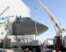 Airplane Picture - Contractors dismantle the Boeing 747 fuselage portion of the System Integration Laboratory at the Birk Flight Test Center.