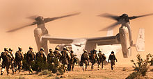 Airplane Picture - Marines prepare to board an MV-22 at Marine Corps Air Ground Combat Center Twentynine Palms in 2010.