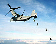Airplane Picture - U.S. Marines jump from an Osprey.