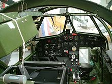 Airplane Picture - Blenheim Mk IV cockpit. Note the asymmetry of the instrument console, indicating the position of the scooped out area of the nose in front of the pilot. The ring and bead gunsight for the forward firing guns is visible.