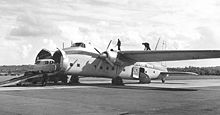 Airplane Picture - Silver City Airways Freighter 32 loading a car for Cherbourg at Southampton in September 1954