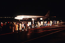 Airplane Picture - Spectators watch one of two C-137B Stratoliner aircraft returning freed hostages after their release from Iran in 1981