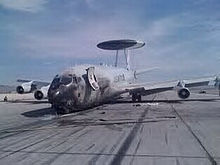 Airplane Picture - Fire-damaged USAF E-3 on Nellis AFB, NV ramp.
