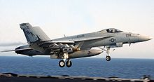 Airplane Picture - A U.S. Navy F/A-18E above the deck of USS Abraham Lincoln in 2002