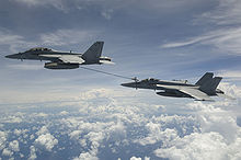 Airplane Picture - An F/A-18F refueling an F/A-18E over the Bay of Bengal, 2007