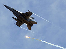 Airplane Picture - A VFA-11 F/A-18F Super Hornet performing evasive maneuvers during an air power demonstration