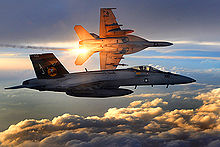 Airplane Picture - Two U.S. Navy F/A-18 Super Hornets fly a combat patrol over Afghanistan in 2008. The aircraft banking away in the background can be seen launching infra-red countermeasure flares.