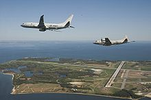 Airplane Picture - The U.S. Navy's newest maritime patrol and reconnaissance aircraft, P-8A Poseidon flies with a P-3 Orion along side, prior to landing at Naval Air Station Patuxent River, Maryland in 2010.