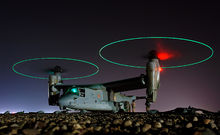 Airplane Picture - Crew members refuel an MV-22 before a night mission in central Iraq, February 2008.