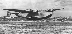 "Warbird Picture - A Boeing 314 ""Clipper"" flying low"