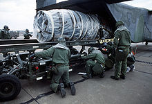 Airplane Picture - A C-23A with an aircraft engine being unloaded.