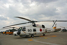 Airplane Picture - A JMSDF SH-60J in Okadama Airport, with a JASDF UH-60J behind it.