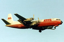 Airplane Picture - Merchantman of Air Bridge Carriers, in DHL colours, landing at Manchester Airport in 1992
