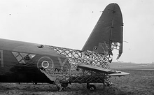 Airplane Picture - Wellington Mark X HE239 of No.428 Sqn. RCAF, illustrating the geodesic construction and the level of punishment it could absorb while maintaining integrity and airworthiness.
