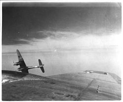 Airplane Picture - An Me 410A-1/U4 with a BK 5 autocannon finishes its attack on a USAAF B-17