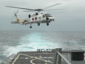 Warbird Picture - A JMSDF SH-60J Seahawk helicopter from JS Haruna (DDH 141) lands onboard USS Russell (DDG 59) in 2007.