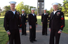 Airplane Picture - Petty Officers wearing service dress uniforms pose for a photograph in front of the Netherlands Carillon at Arlington National Cemetery.