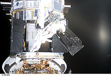 Airplane Picture - NASA astronauts of Space Shuttle mission STS-109 remove FOC during an EVA