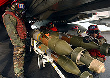Airplane Picture - Aviation Ordnancemen loading GBU-12 bombs.