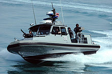 Airplane Picture - Members of Inshore Boat Unit 24 patrol near Kuwait Naval Base.