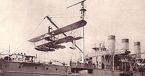 Airplane Picture - A Caudron seaplane, being craned on La Foudre in April 1914