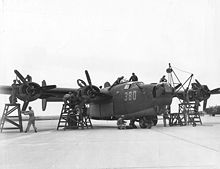 Airplane Picture - Maintenance mechanics at Laredo Army Air Field, Texas, give a Consolidated B-24 Liberator a complete overhaul before flight, 8 February 1944.