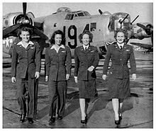 Airplane Picture - WASP pilots (left to right) Eloise Huffines Bailey, Millie Davidson Dalrymple, Elizabeth McKethan Magid and Clara Jo Marsh Stember, with a B-24 in the background