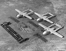 Airplane Picture - Three C-82s and various troops and cargo in 1948